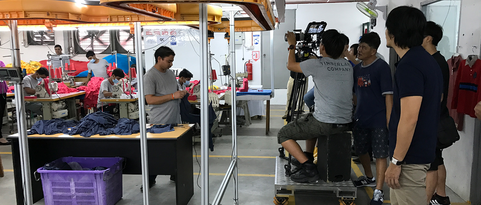 big production crew working for a textile factory corporate video