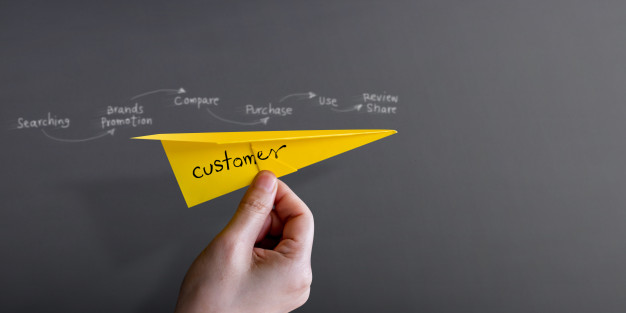customer journey experience concept hand raise up paper plane against wall 34048 533