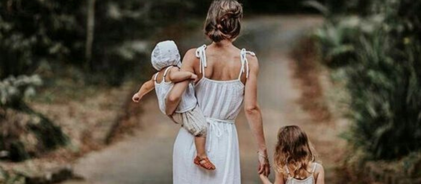 Mom with two kids, white dresses