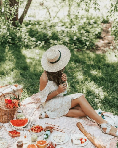 Girl with wide brim hat, outdoor picnic