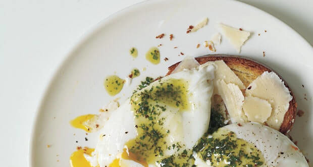 pesto, poached eggs on plate