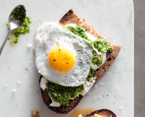 poached egg with pesto sauce on toast