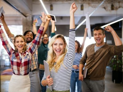 happy-business-people-celebrating-success-at-company.jpg