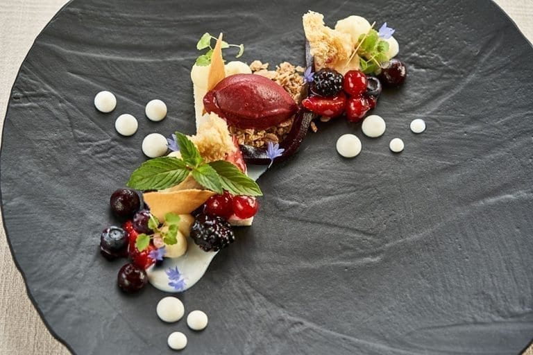 Semolina flame with forest berry textures and almond biscuit; Hotel Gasthof Post, Lech am Arlberg, Vorarlberg (Austria)