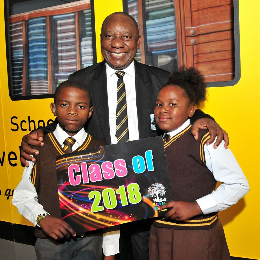 Chairperson of Adopt-a-School Foundation, President Cyril Ramaphosa (middle) with Rotondwa Masuanyise (left) and Asakundwi Munyai (right) from Tshilidzi Primary School in Soweto, who acted as Masters of Ceremonies at Adopt-a-School Foundation's 12th annual 'Back to School' party on Saturday.