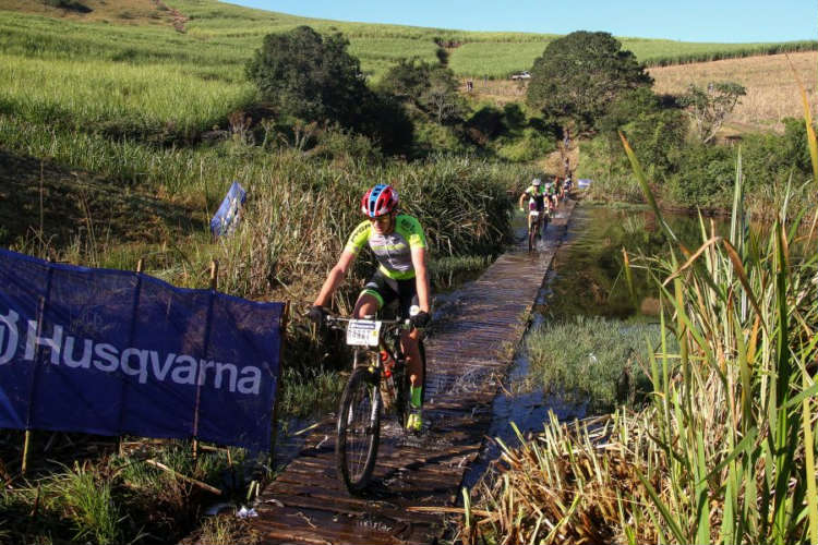 Julian Jessop leads the field across a floating bridge early in the HusqvarnaClassic Mid-Illovo MTB Challenge and Trail Run.