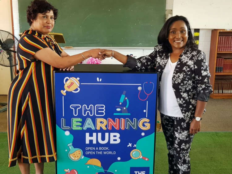 Seen at the handover event was Principal Mrs Pillay with Loshnee Bridgmohan of THE HUB