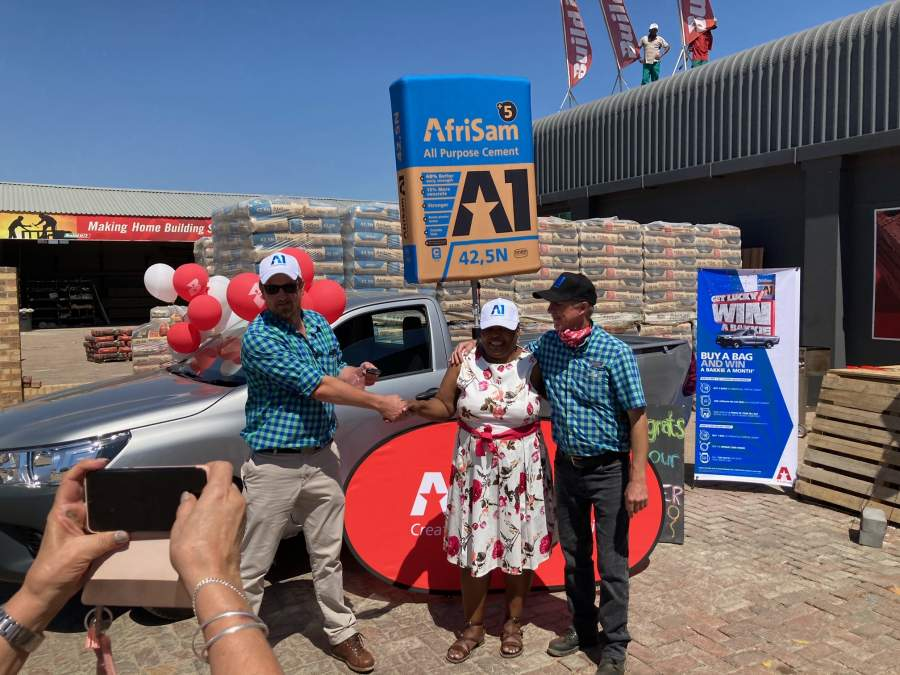 Harry van der Schyff and Martin Nuttal from Pula BuildIt, celebrating with Pauline Nhlapo.