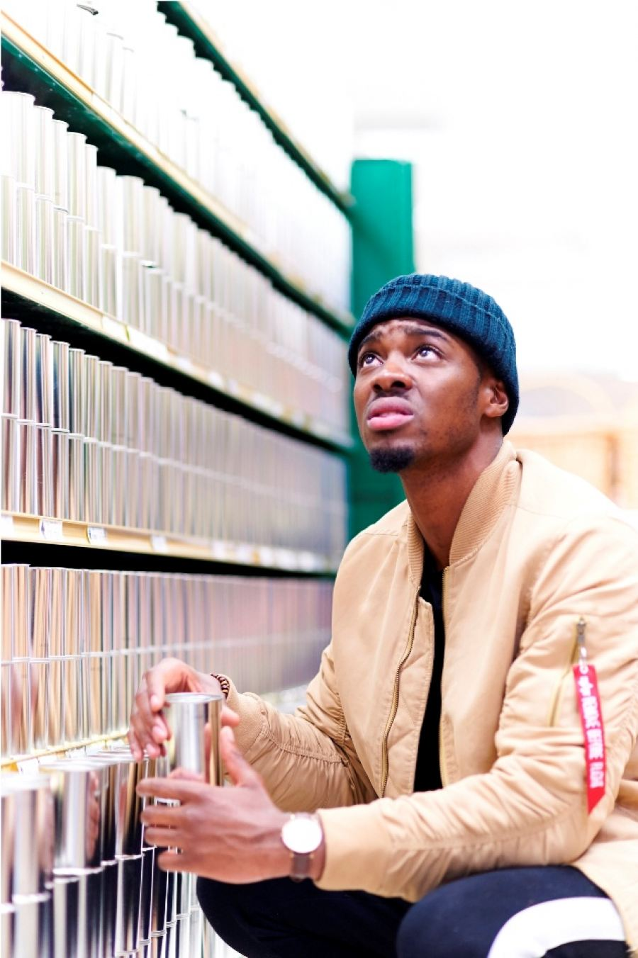 TV presenter Tino Chinyani navigate the supermarket aisles trying to buy something when confronted with shelves of identical silver unlabeled tins