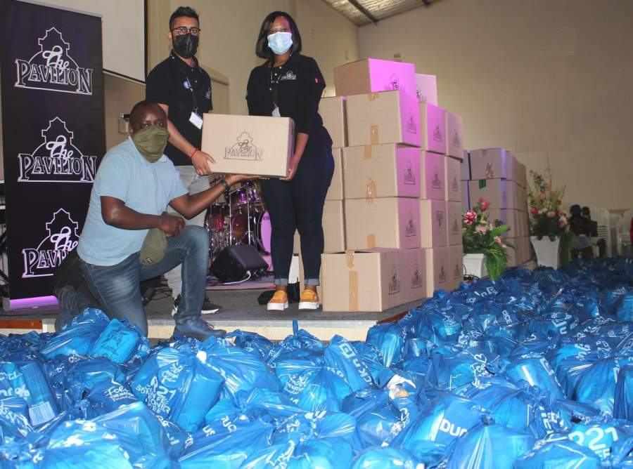 #StrongerTogether - Seen with the first batch of food parcels handed over to local Chesterville community leader, Thamsanqa Zondo together with the Pavilion Shopping Centre marketing team, Avesh Udiajoo and Julie-anne Zuma.