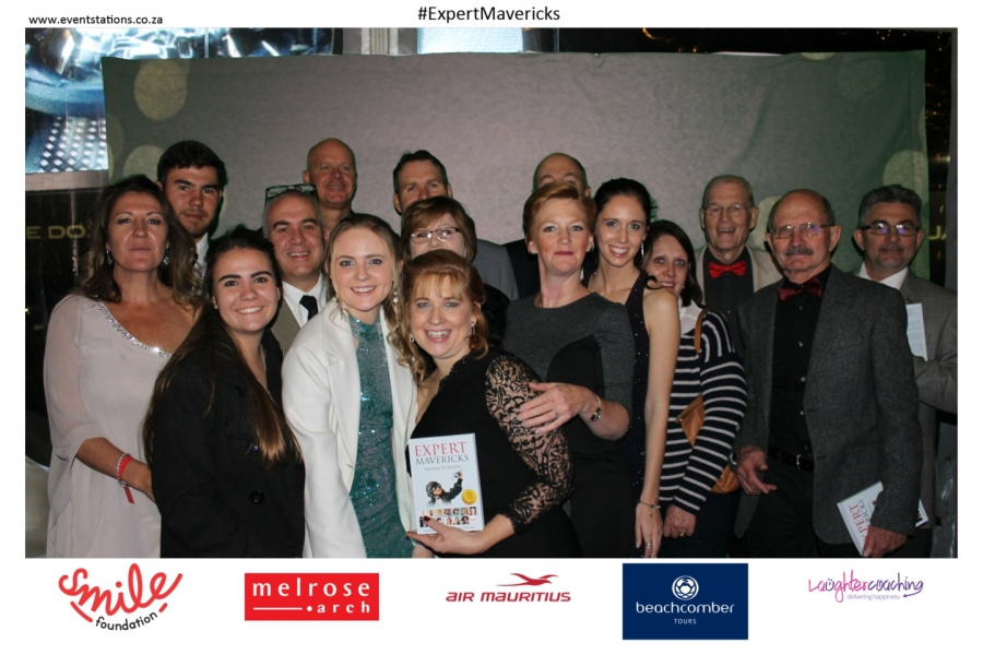 """Tandy Coleman (centre, holding the book) was joined by friends and family at the launch of """"Expert Mavericks"""" which took place at a gala event held at Melrose Arch in Johannesburg recently."""