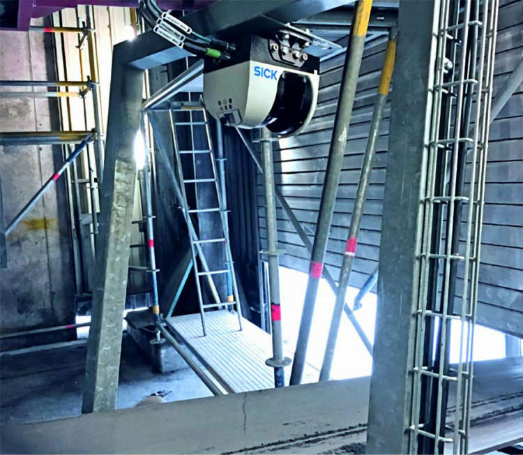 The SICK Automation Bulkscan® LMS511 mounted above the conveyor                            system at the Heidelberg Cement AG plant in Lengfurtt,                          Germany.