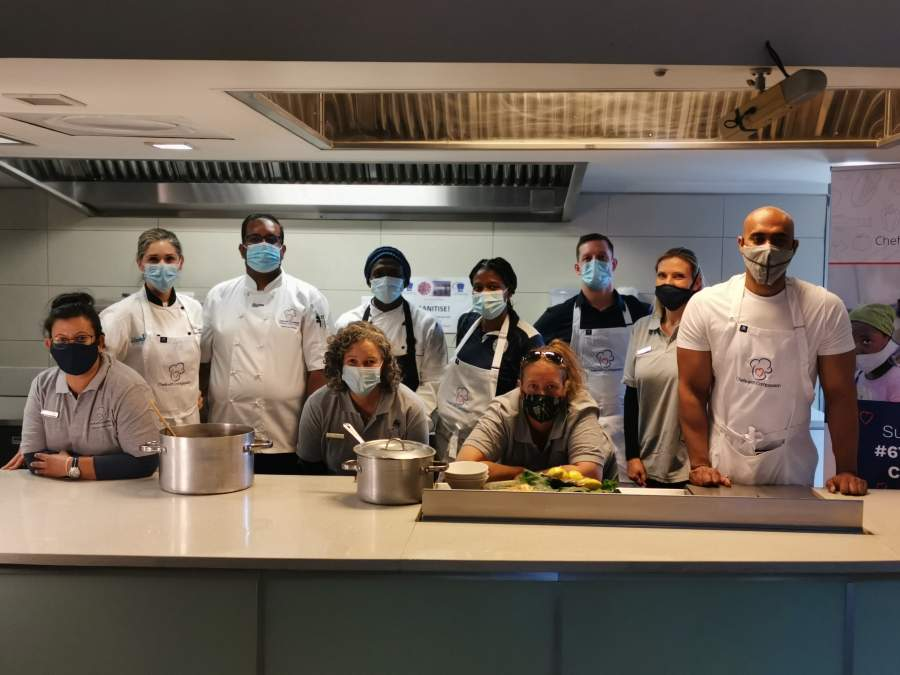 Yejna Maharaj (SA Chefs), Sasha Zambetti (celebrity chef), Coo Pillay (Chefs with Compassion), Keanetswe Sematle (Chefs with Compassion volunteer), Lebo Lekotoko (NDS Chefs Academy), Tom Savage (Buns Out), Vanessa Naude (Chefs with Compassion), Ismail Ismail (Compass Insure). Front: Marion Tanzer (Chefs with Compassion) and Hanneke van Linge (Chefs with Compassion).
