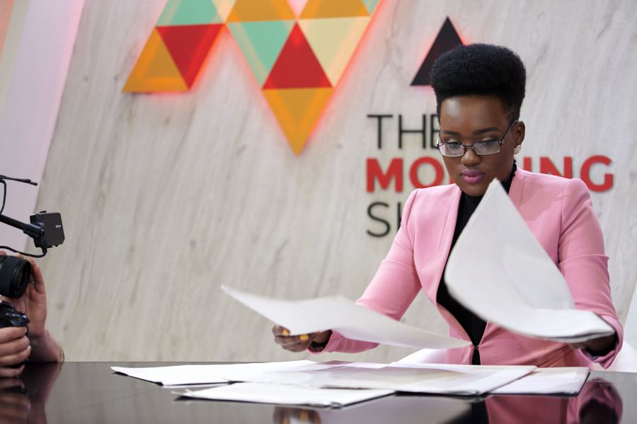 Tumelo Mothotoane tries to read the headlines without the printed word