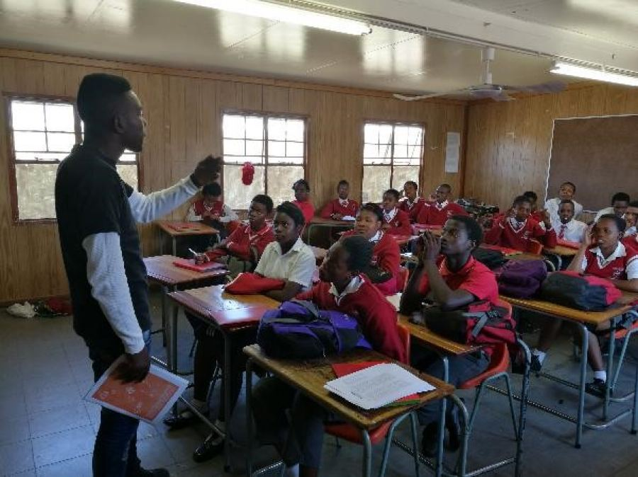 Caption: Columba Leadership alumni (Domingo Nkuna), instructs learners as part of the 'Absa ReadytoWork' programme, where they received training on essential skills needed to gain future employment.