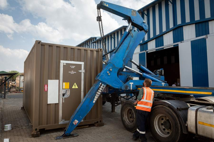 Technicians load BlueNova's iESS (intelligent Energy Storage System) onto a truck as it is prepared to be sent to Timibila Nature Reserve in Namibia. The 1MWh battery will form the heart of a solar powered, off grid solution for the reserve.