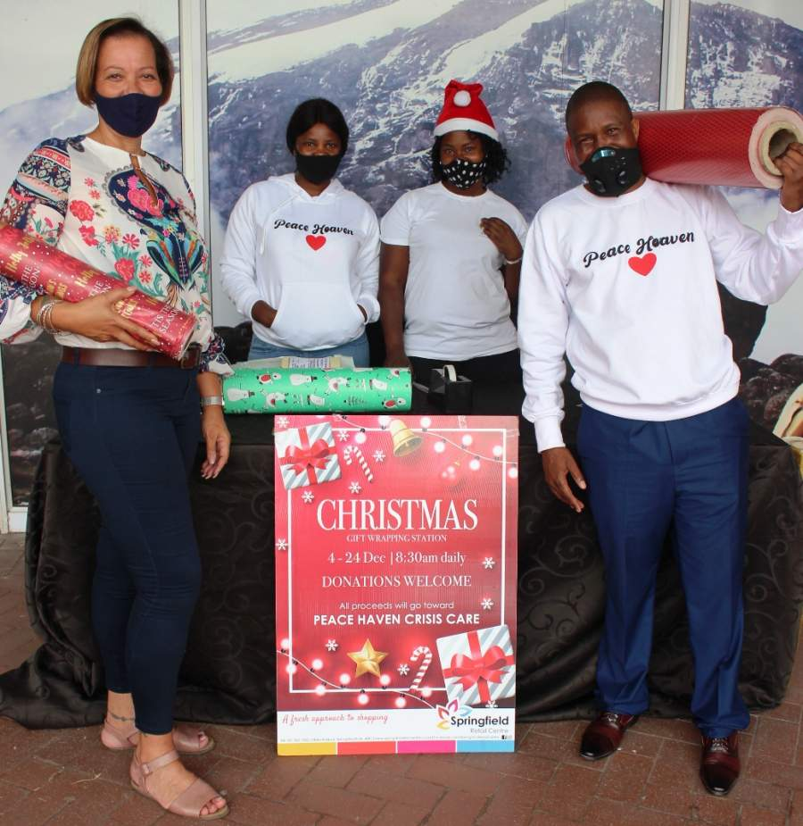 LEND YOUR SUPPORT TO THE PEACE HAVEN CRISIS CARE UNIT!: Bernice Clarisse (The Property Manager under the Broll Property Group) with the Peace Haven Crisis Care Unit team, Mavis Ndimande, Melody Chataka and Pastor Sibusiso Ndimande on standing ready to wrap that gift for your loved one!