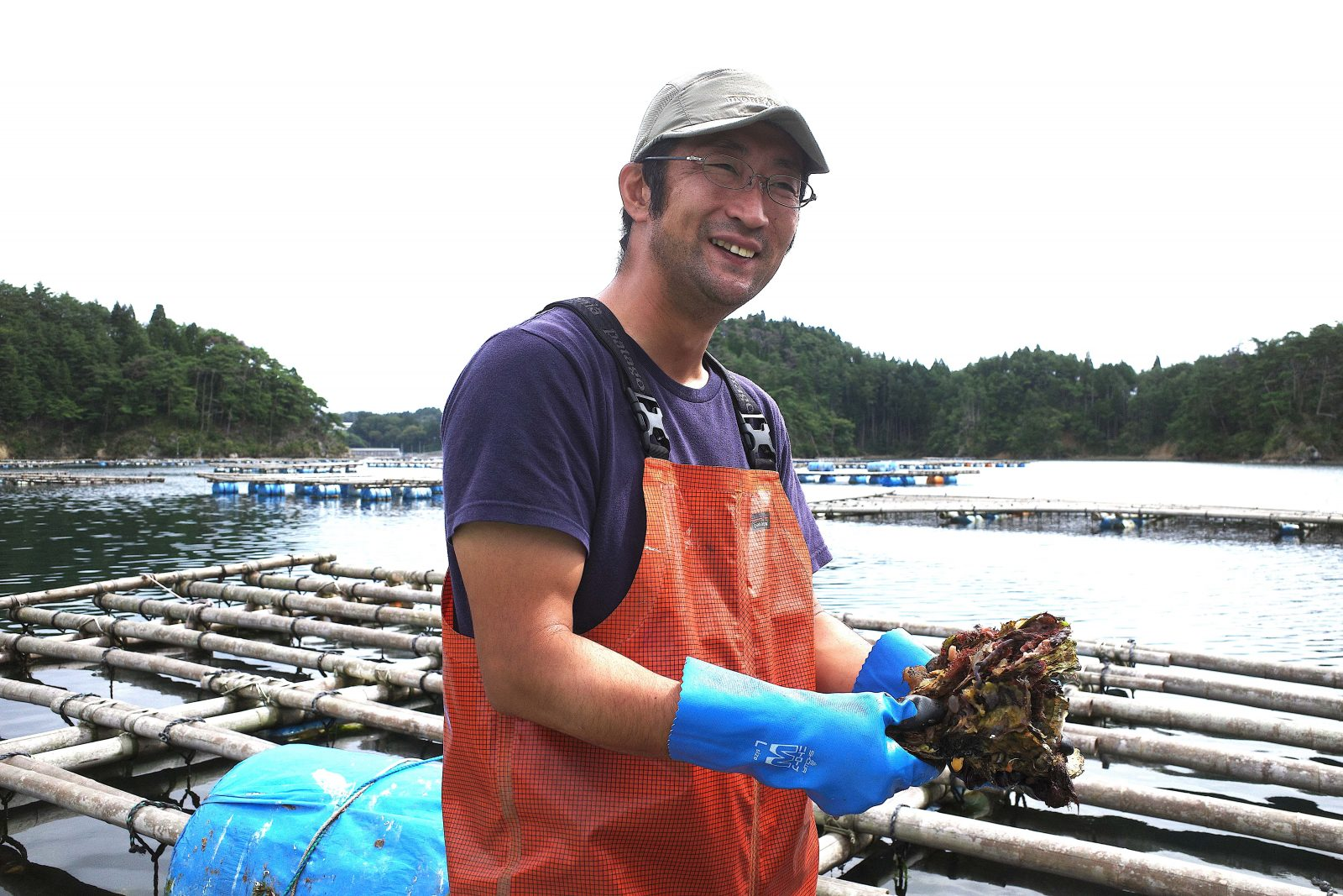 An oyster farmer explaining the process of growing oysters