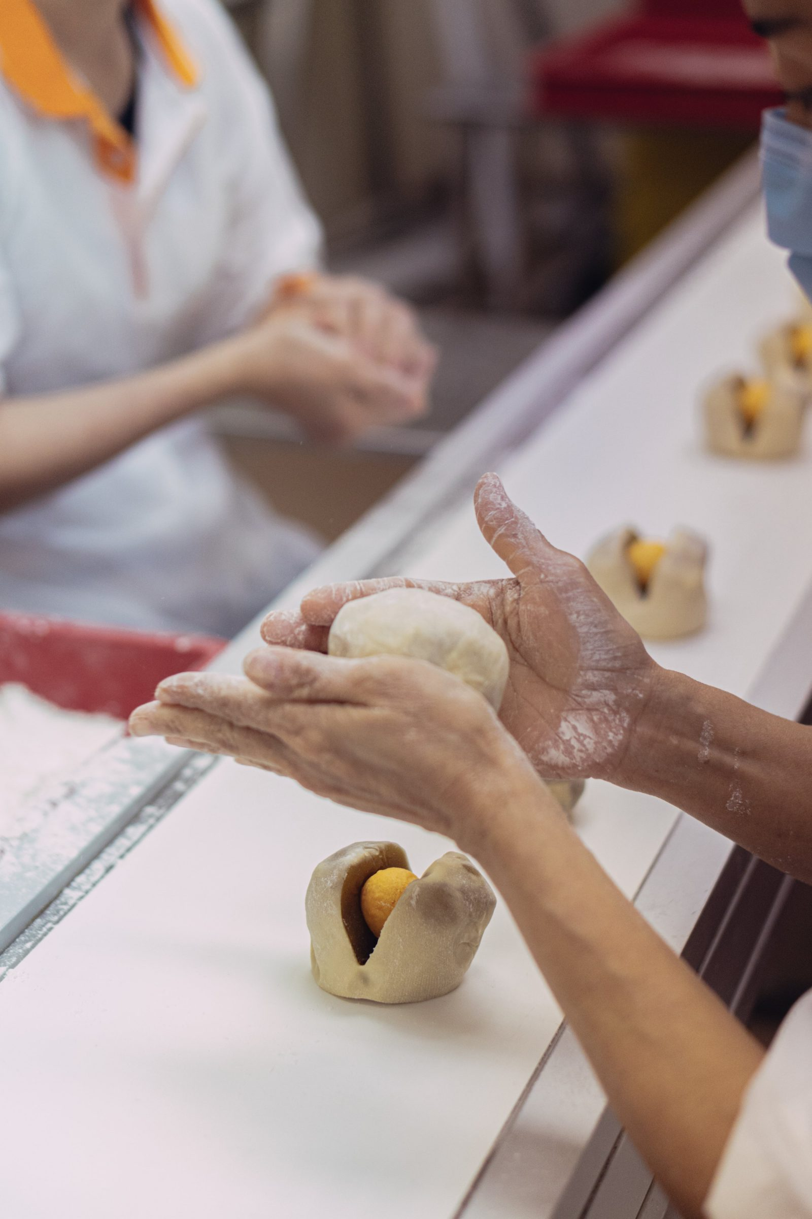 Bake Mission's mooncakes are carefully shaped by hand by a team of dedicated craftsmen