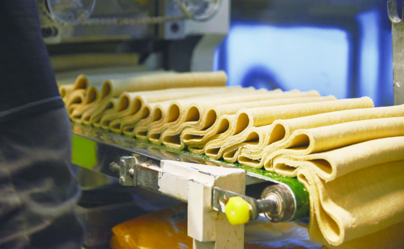 Noodle dough rolled into smooth sheets
