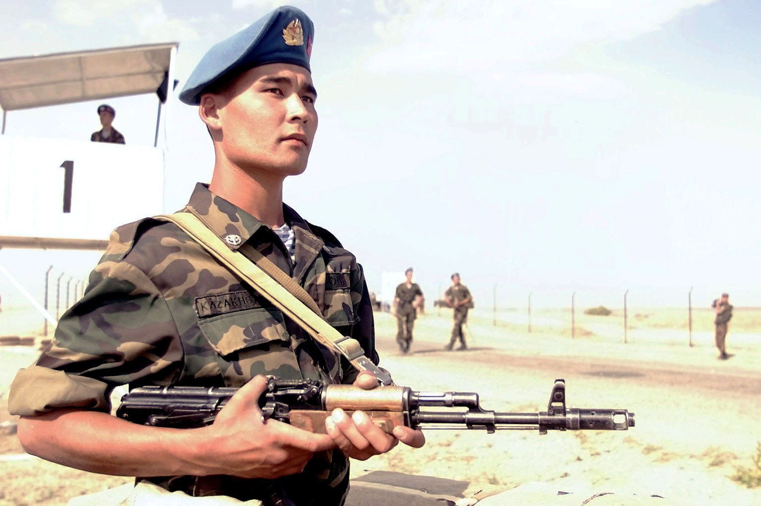 A Kazakhstan soldier, armed with 5.45 mm AK-74 assult rifle, mans a check point during the start of Central Asian Peacekeeping Battalion (CENTRASBAT) 2000. CENTRASBAT 2000 is a multi-national peacekeeping and humanitarian relief exercise sponsored by United States Central Command (US CENTCOM) and hosted by the former Soviet Republic Kazakhstan in Central Asia, 11-20 September 2000. Exercise participants include approximately 300 US troops including personnel from US CENTCOM, the US Army's 82nd Airborne Division, Fort Bragg, North Carolina, and 5th Special Forces Group, Ft. Campbell, Kentucky, and 300 Kazakhstan soldiers. Other participating nations include: Uzbekistan, Kyrgystan, The United Kingdom, Turkey, Russia, Georgia, Azerbaijan and Mongolia. CENTRASBAT originated in 1996, and was established to form a joint battalion of soldiers from the former Soviet Republics of Kazakhstan, Kyrgystan and Uzbekistan to serve as a key component in developing a regional security and cooperation structure. CENTRASBAT 2000 will test US and Central Asian unit's combat readiness and ability to conduct peacekeeping and humanitarian operations, as well as develop and build cooperative relationships between the respective states and assist in laying the foundation for future peacekeeping and humanitarian operations. Almaty, Kazakhstan (KAZ), 15 September 2000.