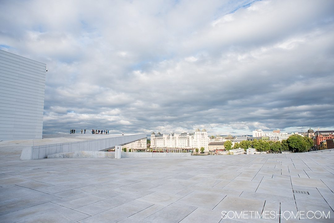 10 Not-to-Miss Sites in Oslo Norway by Sometimes Home travel blog. Photo of the view from on top of Oslo's Opera House roof.