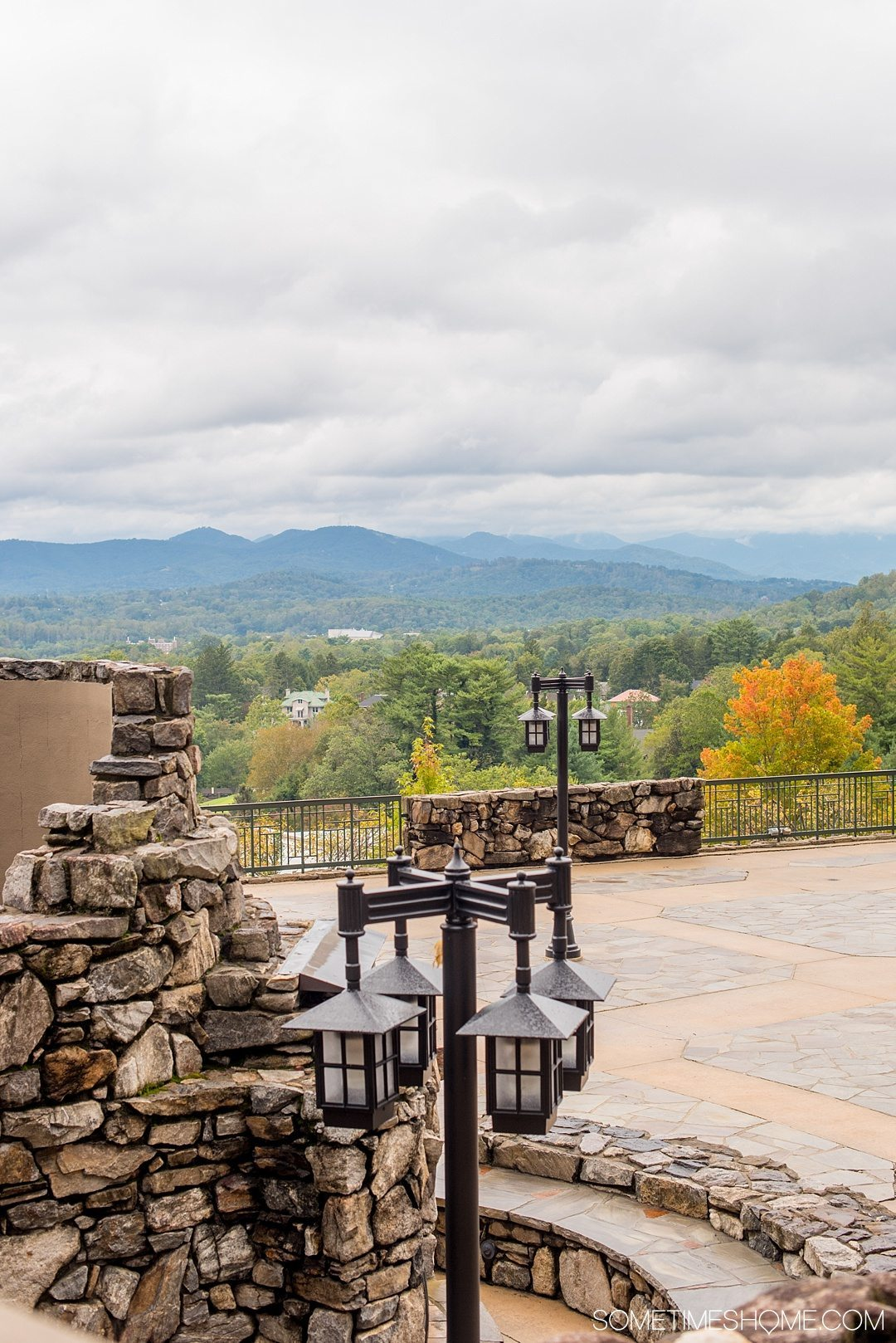 Where to find beer and art in Asheville North Carolina. Photos and locations on Sometimes Home travel blog, including Omni Grove Park Inn's Edison bar with a bee inspired cocktail and beautiful view of the Blue Ridge Mountains.