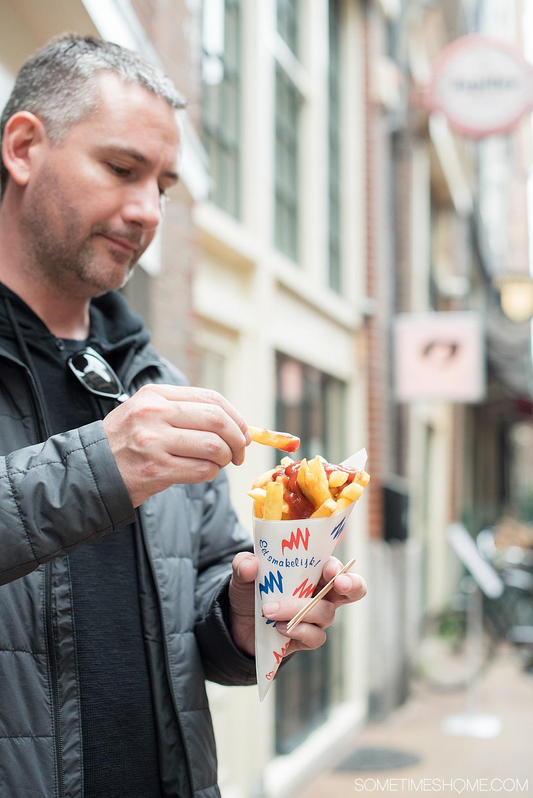 Traditional Dutch foods and drinks to taste in The Netherlands. From Amsterdam desserts to drinks in Holland, cheese in the countryside and more we have your list of snacks and sweets to taste including Herring fish, mini pancakes poffertjes, and stroopwafels. #SometimesHome #TheNetherlands #TraditionalFoods #Dutch #Holland #TypicalCuisine #DutchBeer #DutchFood #AmsterdamArea #DutchFries