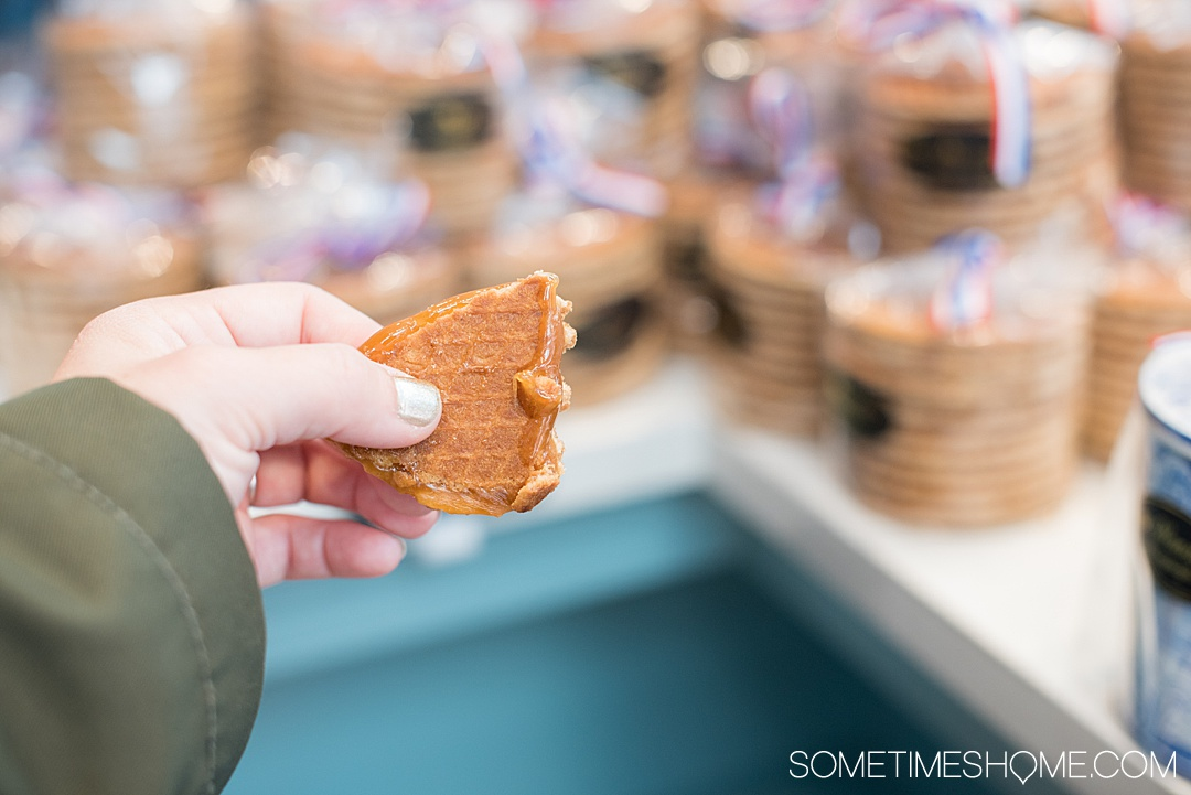 Traditional Dutch foods and drinks to taste in The Netherlands. From Amsterdam desserts to drinks in Holland, cheese in the countryside and more we have your list of snacks and sweets to taste including Herring fish, mini pancakes poffertjes, and stroopwafels. #SometimesHome #TheNetherlands #TraditionalFoods #Dutch #Holland #TypicalCuisine #DutchBeer #DutchFood #AmsterdamArea