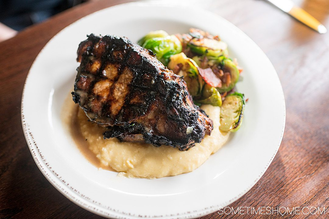 Pork chop, grits and Brussels sprouts dish at a York, PA restaurant