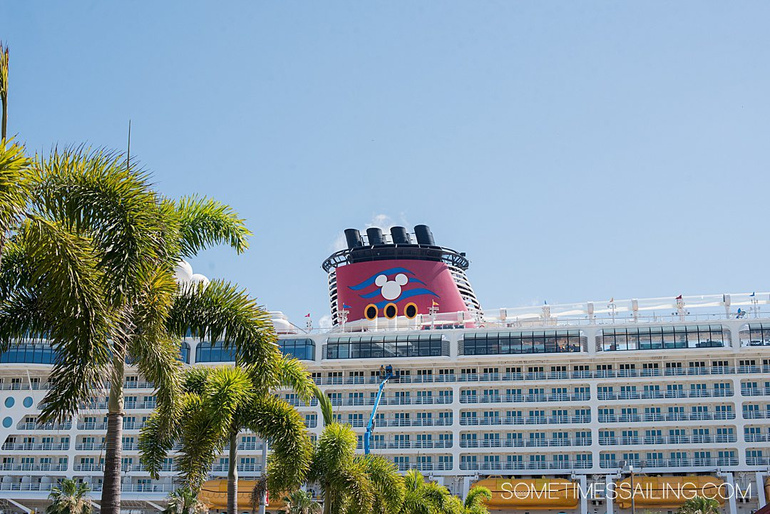 Photo of the red stack of a Disney Cruise Line ship with a Mickey Mouse head silhouette.