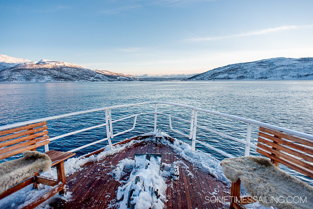 The bow of a ship on a Polar Fjord Boat Tour in Tromso, Norway with ice onboard.