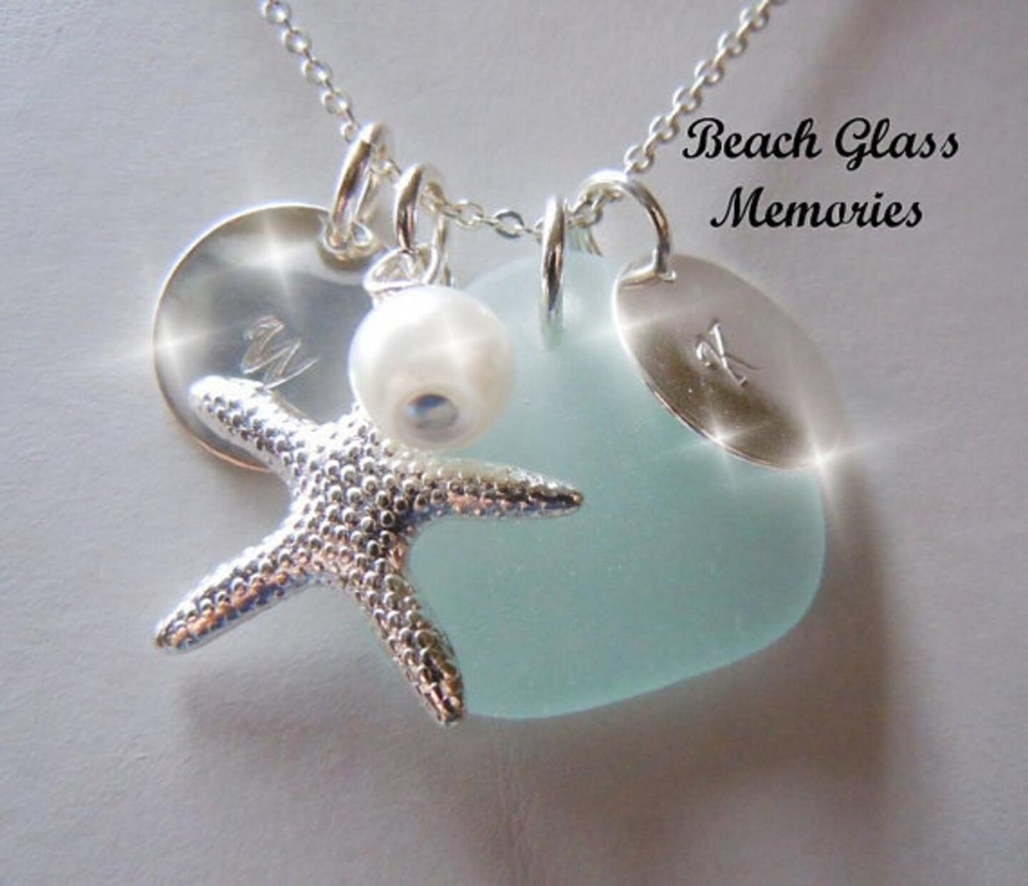 Beach glass jewelry from Etsy with a pearl, starfish and circle letter charm for great ideas for gifts for cruise lovers.