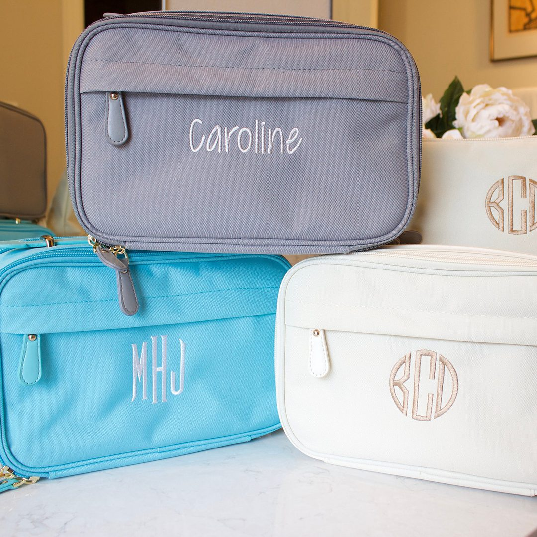 Grey, blue and white personalized toiletry cases.