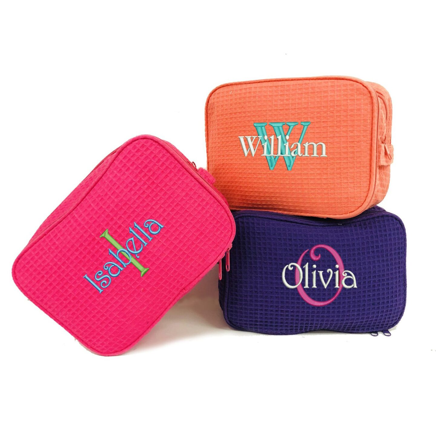 Pink, orange and purple personalized waffle fabric toiletry cases for cruise gift ideas.
