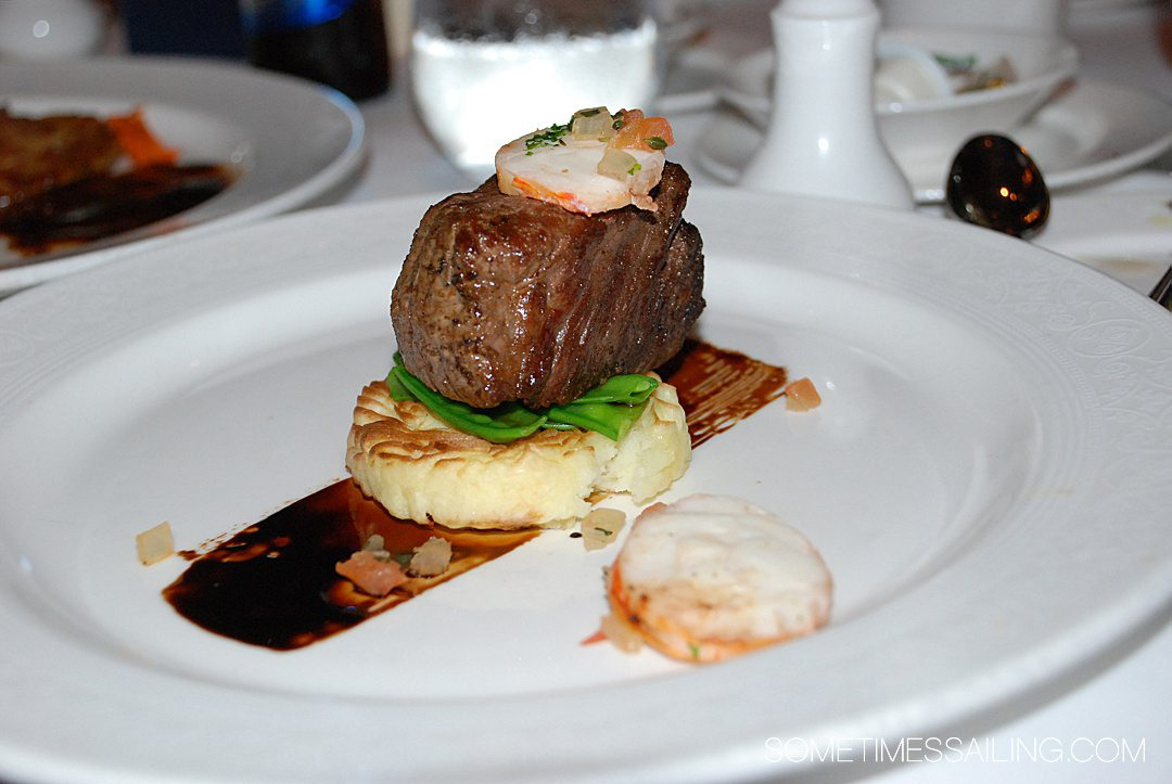 Plated entree with steak and mashed potatoes at a meal aboard Disney Cruise Line's Dream ship.