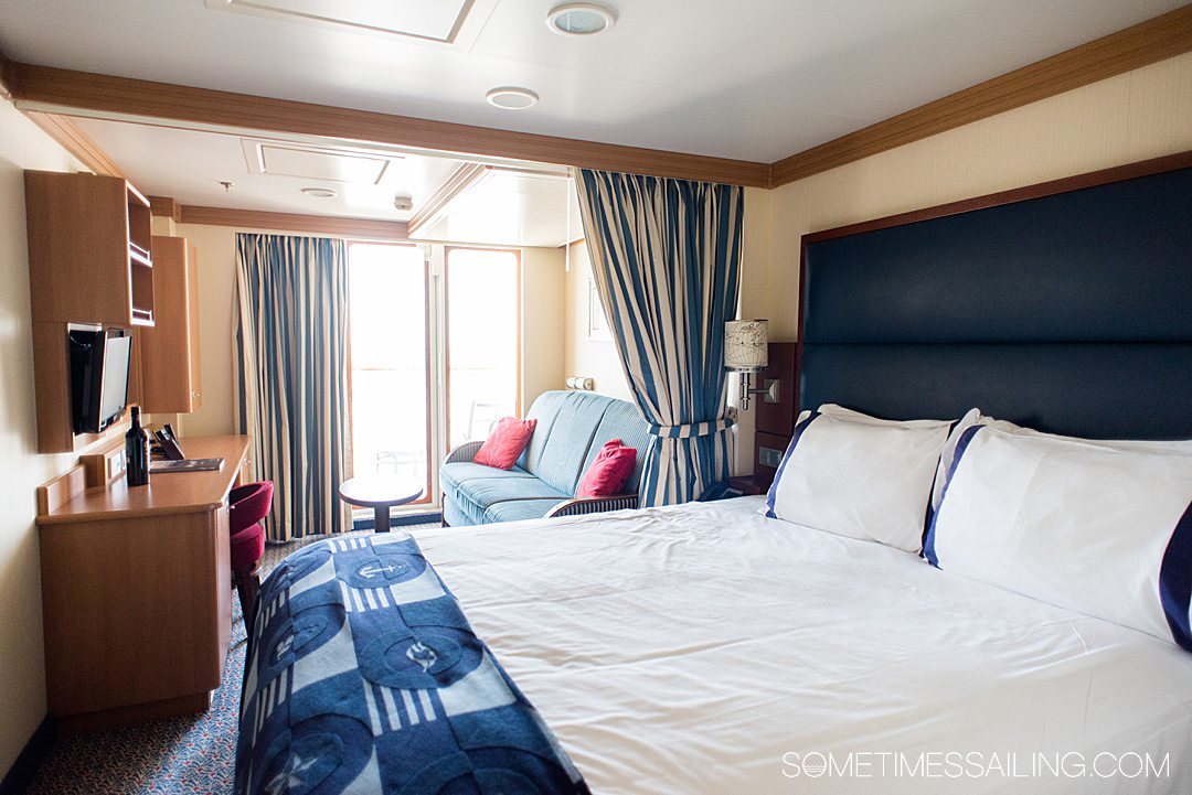 Interior of a cabin on the Disney Dream cruise line ship with blue and white bedding.