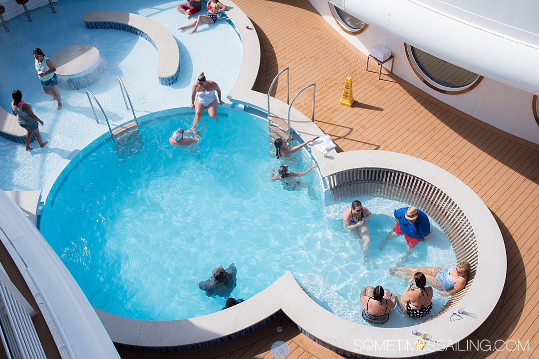 Looking down on a circle pool on the top deck of a cruise ship, an adult-only area for people on Disney cruise, without kids.