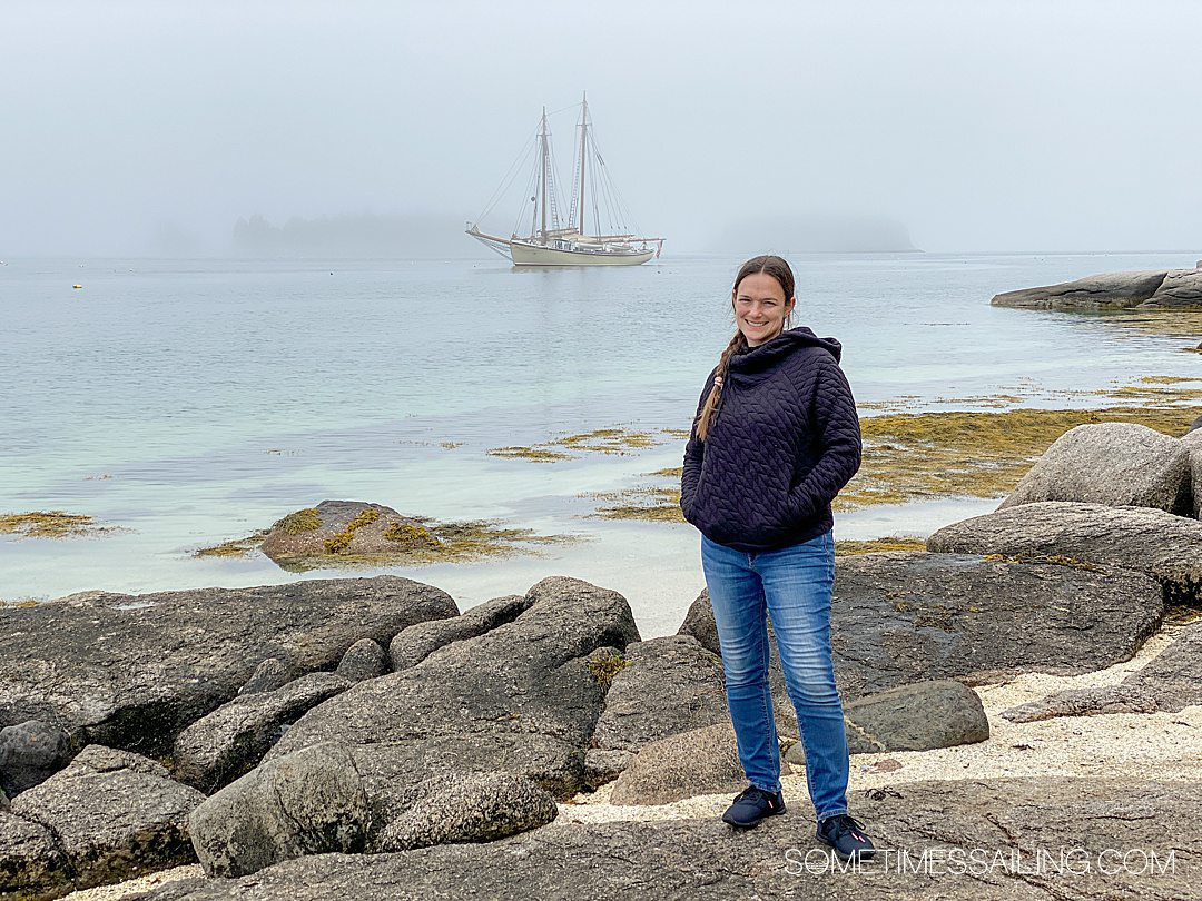 Woman on the shore of Russ Island during a Maine Windjammer Association cruise.