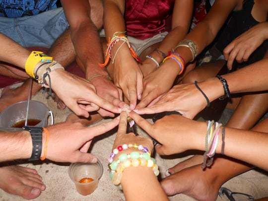 Travellers in South East Asia adorned with friendship bracelets.