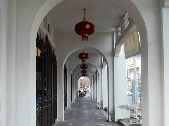 Arched walkways are used to connect shop-houses and protect people from the harsh sun