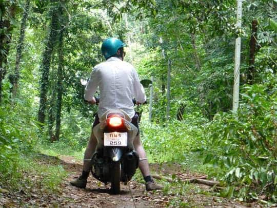 The Back of a Man on a Motorbike in the Jungle on Koh Kood