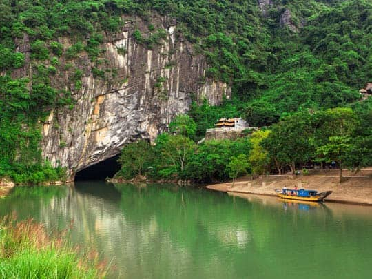 A boat about to enter the Tu Lan Cave System