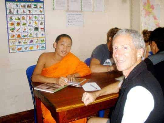 A Monk speaks to a middle aged Western man Vientiane Laos
