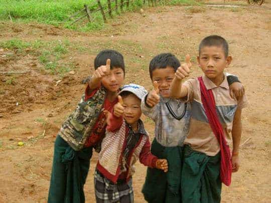 """Local kids give a """"thumbs up"""" on the trek from Kalaw to Inle Lake."""