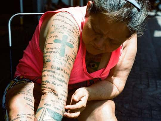 Woman with tattooed arm. Analog photography