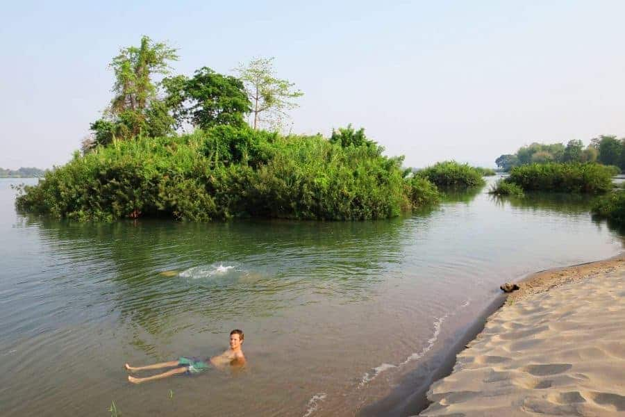 Guy relaxes in Don Det, Four Thousand Islands, Laos
