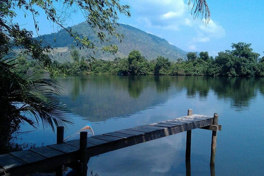 A Wooden Pier Stretches Out Over Kampot River