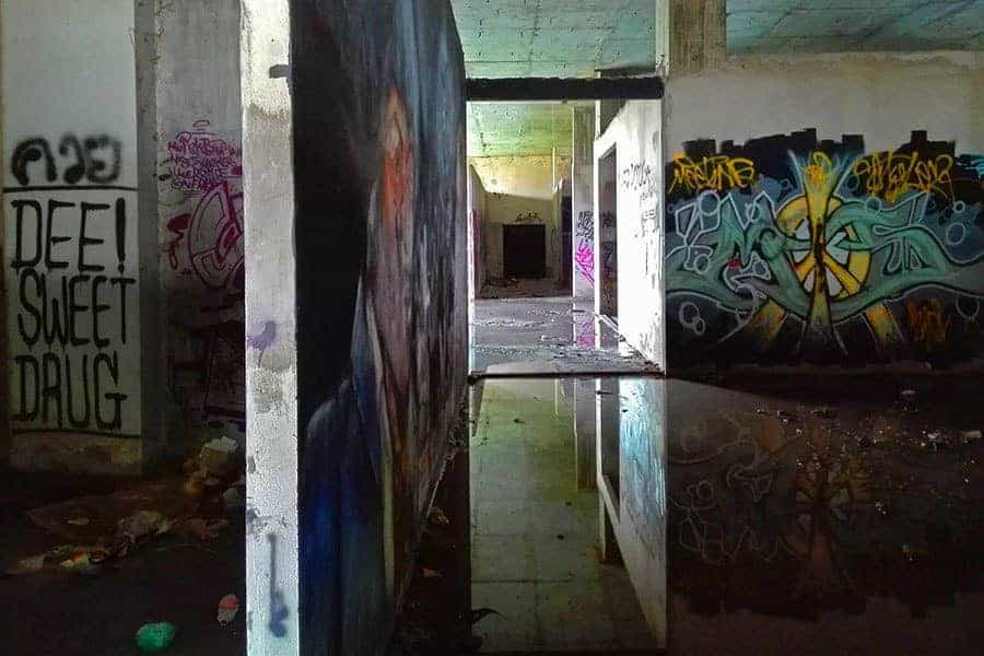 Grafitti-and-puddles-in-abandoned-building-off-main-road-near-Chiang-Mai-Thailand