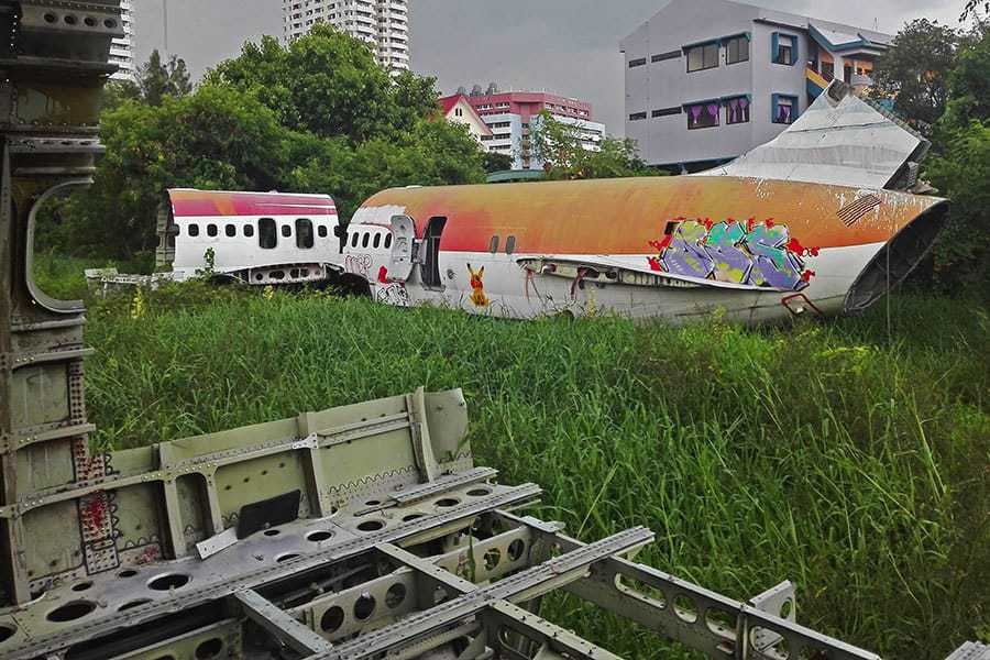 Shot-of-two-small-planes-taken-from-the-inside-of-a-bigger-one-at-the-aeroplane-graveyard,-Bangkok.-Thailand